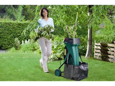 Well maintained garden. Choosing a garden shredder